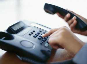 Man pressing button on phone system