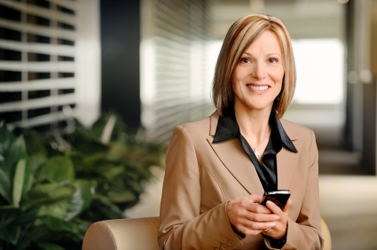 Businesswoman working on mobile device